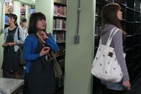 students from Doshisha Women's College tour the library stacks