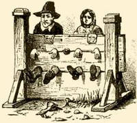 colonial man and woman in stocks