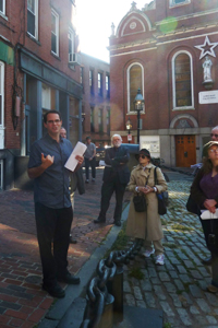 historian Alex Goldfeld welcomes the group in North Square